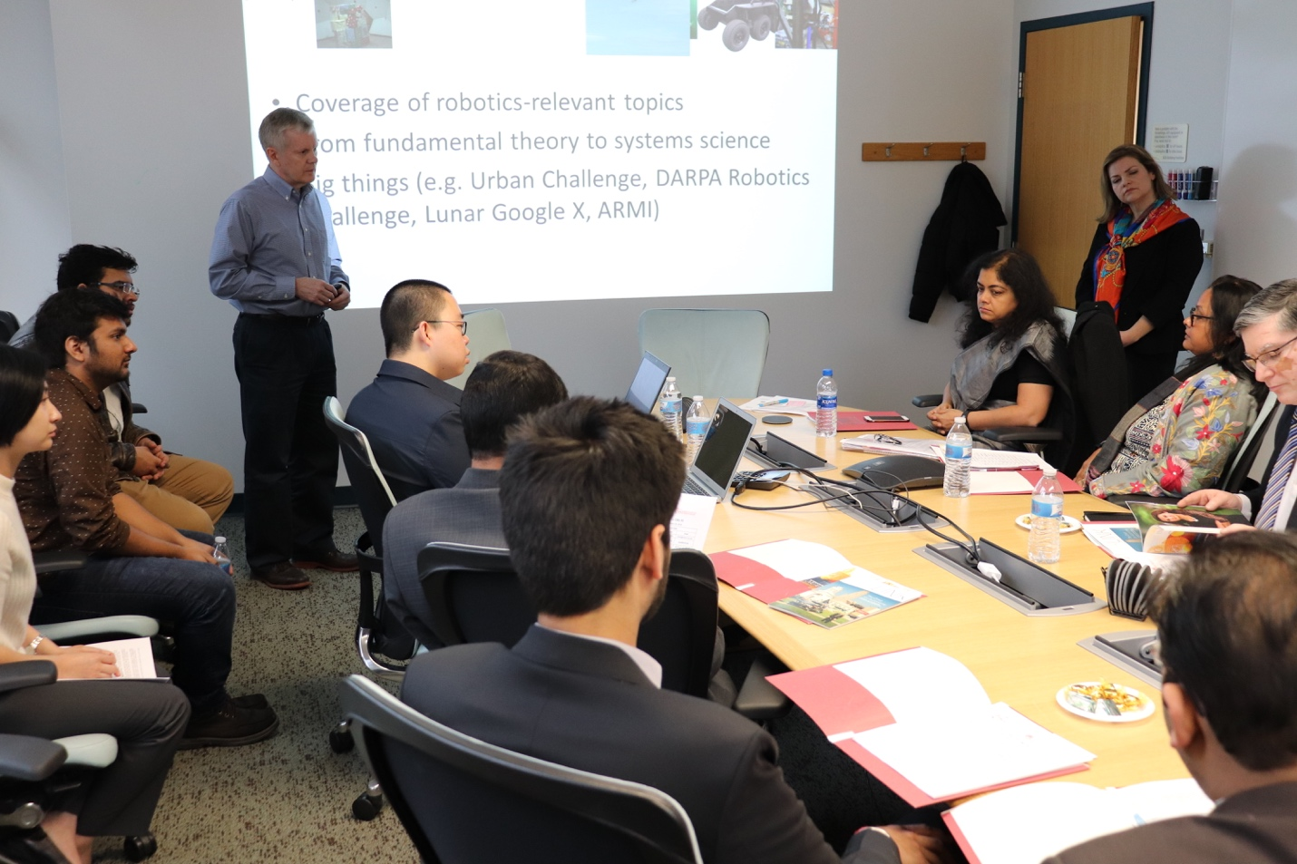 CMU RISS program director Dr. John Dolan presents an overview of CMU Robotics Institute to the FICCI delegation.