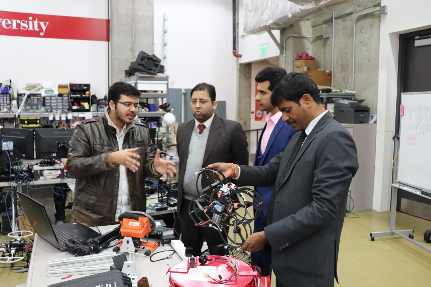RISS alumnus Mr. Mosam Dabhi discusses aerial robotics research in Resilient Intelligent Systems Lab with the FICCI delegation.